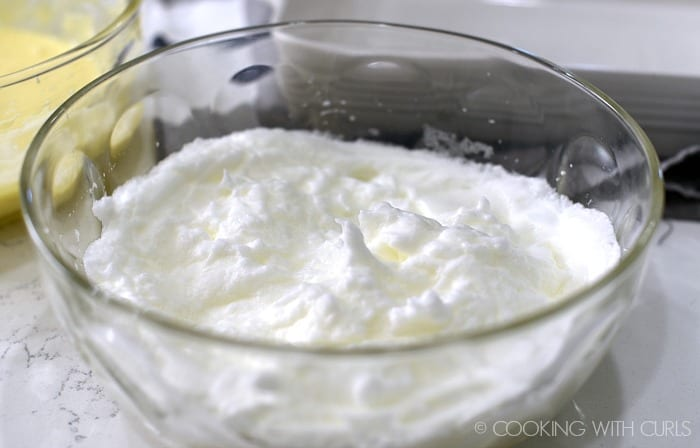Beat egg whites until stiff peaks form © COOKING WITH CURLS