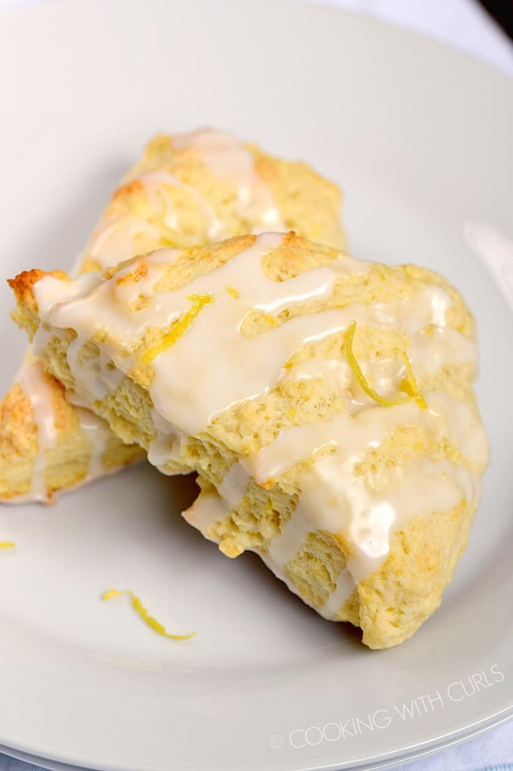 Brighten up your morning with these light and flaky Glazed Lemon Scones! © COOKING WITH CURLS