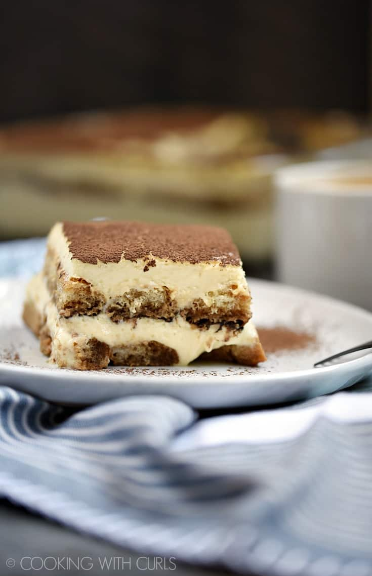 Classic Tiramisu is one of my all-time favorite desserts! Who can resist coffee soaked ladyfingers layered between creamy filling and cocoa powder © COOKING WITH CURLS