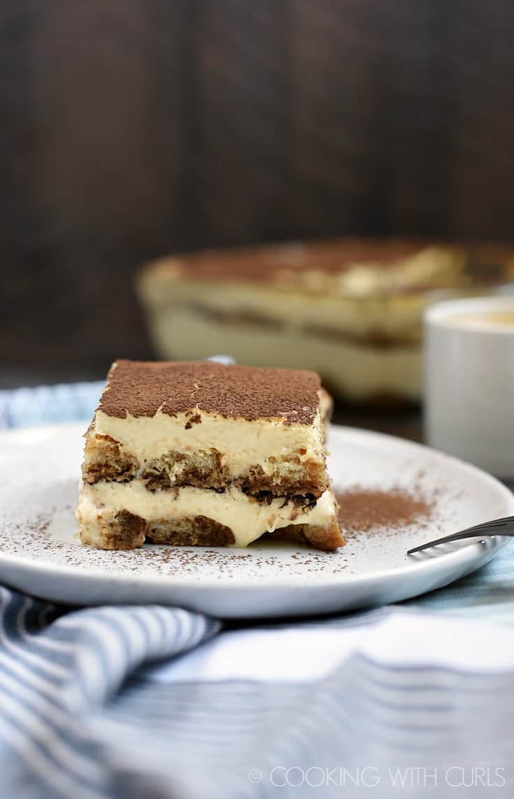 Classic Tiramisu with coffee soaked ladyfingers, creamy filling, and a big dose of cocoa powder! © COOKING WITH CURLS