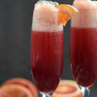 Every celebration needs a signature cocktail, and this Blood Orange Mimosa is perfect addition to your menu! © COOKING WITH CURLS