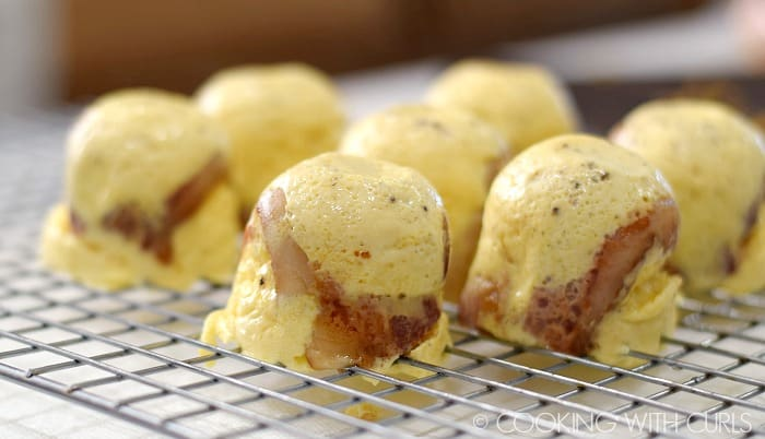 Instant Pot Bacon-Cheddar Egg Bites cooling on a wire rack © COOKING WITH CURLS