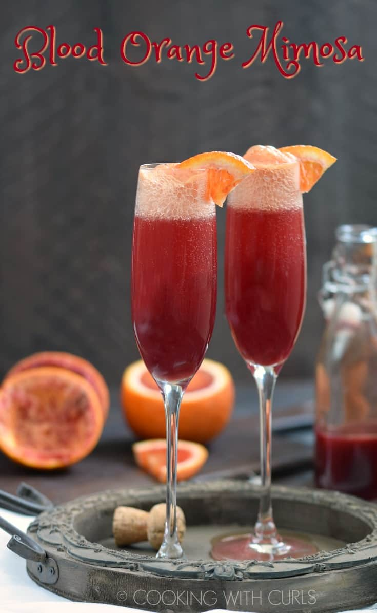 Make your next brunch a bit more special with the addition of a Blood Orange Mimosa to your menu! They are simple to prepare and always a favorite!! #mimosa #champagne #prosecco #bloodoranges #brunch #cocktail