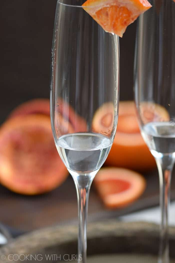 Orange liqueur added to a champagne flute © COOKING WITH CURLS