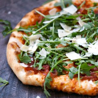 Pizzeria style Prosciutto-Arugula Pizza made at home with simple ingredients and a baking stone! © COOKING WITH CURLS