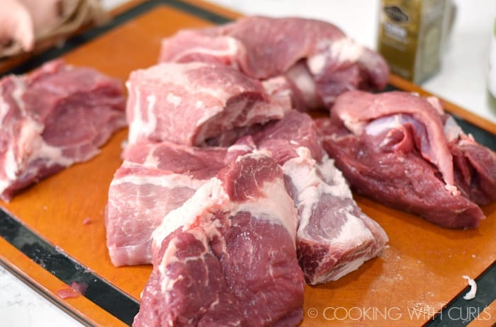 Remove the bone from the pork shoulder and cut into large chunks © COOKING WITH CURLS