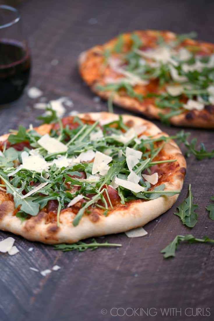 There is no need to delivery when you can make pizzeria quality Prosciutto-Arugula Pizza at home with simple ingredients and a very hot grill or oven! © COOKING WITH CURLS
