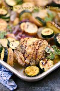 This Sheet Pan Greek Chicken Dinner is quick, easy, and loaded with flavor! © COOKING WITH CURLS