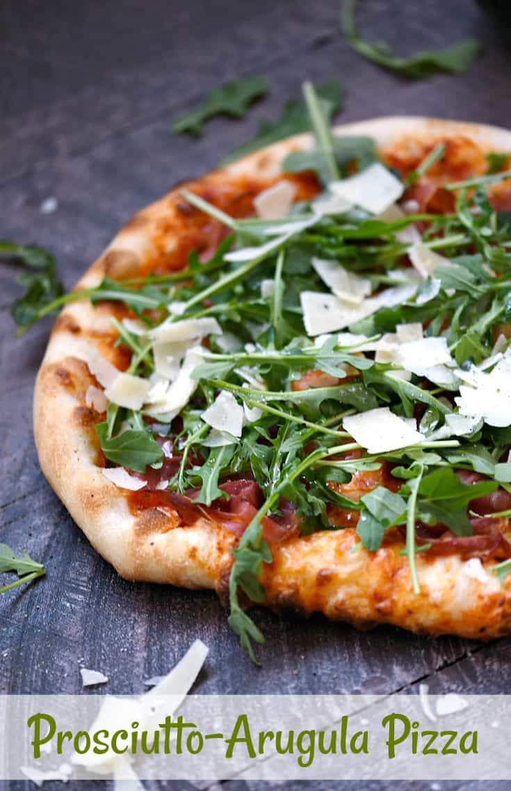 This pizzeria style Prosciutto-Arugula Pizza is made at home with simple ingredients and a baking stone! © COOKING WITH CURLS