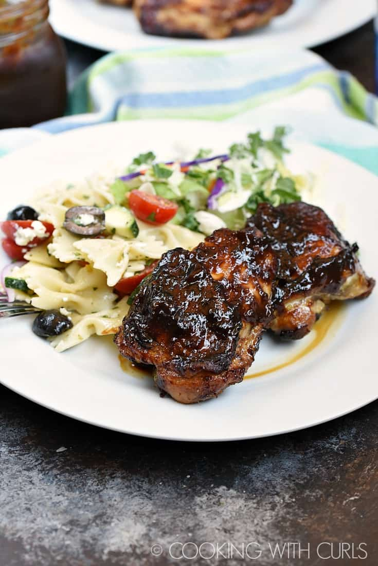 Chicken thighs grilled to perfection and coated with Peach Bourbon Barbecue Sauce © COOKING WITH CURLS