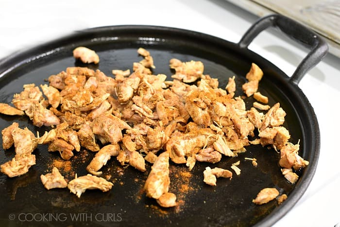 Heat the chopped Chicken Shawarma in a skillet with seasonings © COOKING WITH CURLS