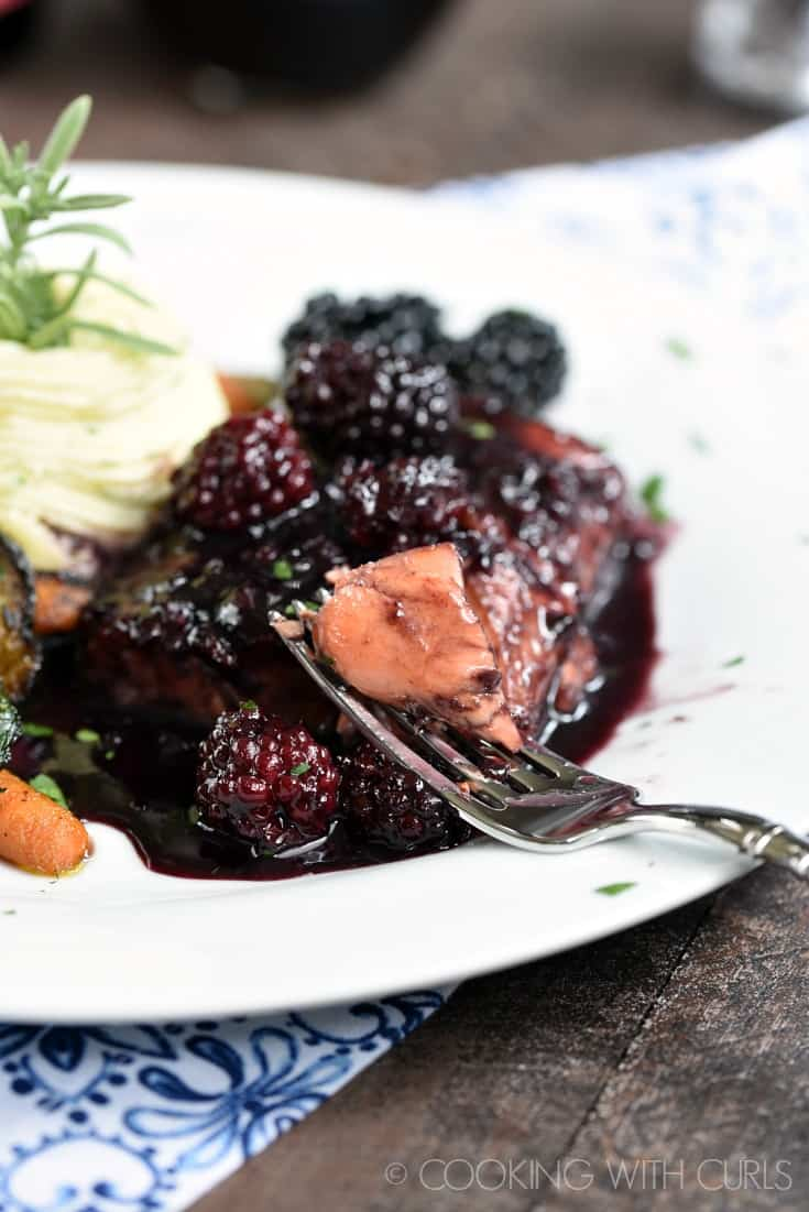 Blackberry Bourbon Glazed Salmon - tender, flaky salmon cooked in a sweet and tangy blackberry sauce create an outstanding meal that is sure to impress!
