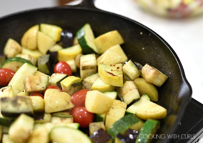 Cook half of the vegetables in a cast iron skillet until charred © COOKING WITH CURLS