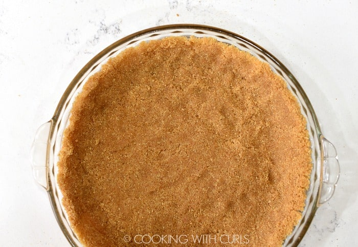 Press the graham crumb mixture evenly into a pie plate © COOKING WITH CURLS