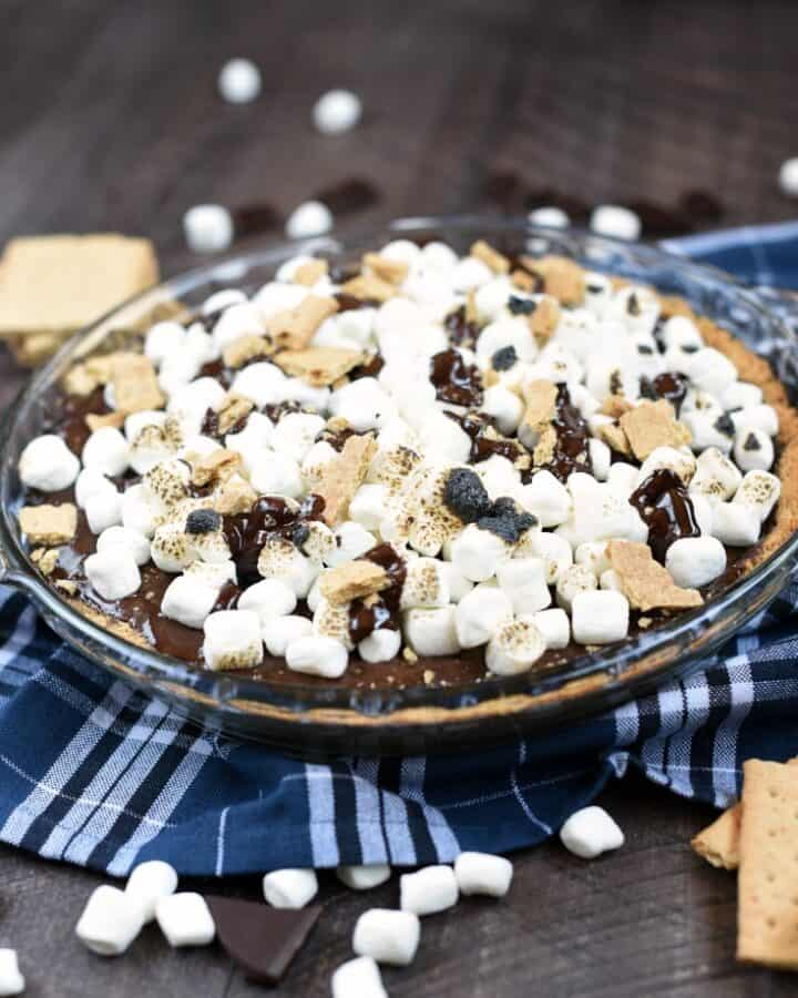 No campfire is required to make this cool and delicious S'mores Ice Cream Pie, although a blow torch is quite helpful!! © COOKING WITH CURLS