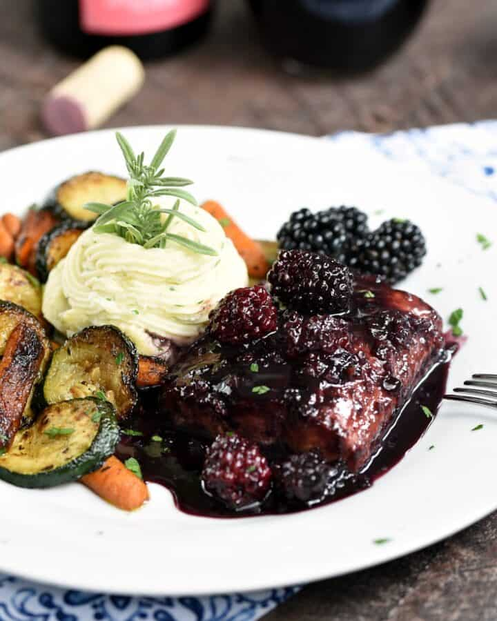 This Blackberry Bourbon Glazed Salmon takes date night to a whole new level! © COOKING WITH CURLS