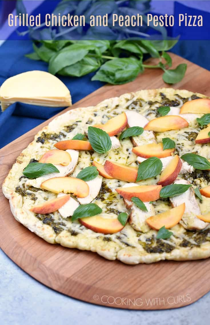 This recipe for Grilled Chicken and Peach Pesto Pizza will come in handy the next time you harvest all of that basil growing in your garden!  #pizza #grilled #peaches #basil #pesto