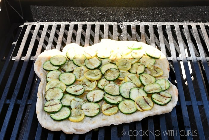 Top the pizza with garlic oil and grilled summer squash © COOKING WITH CURLS