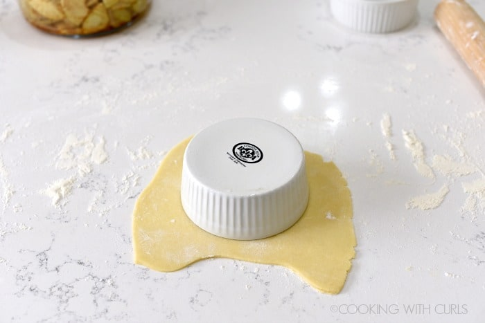 Roll the pie crust out until slightly larger than your ramekin cookingwithcurls.com