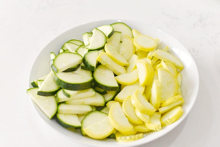 A bowl of zucchini and squash slices cookingwithcurls.com