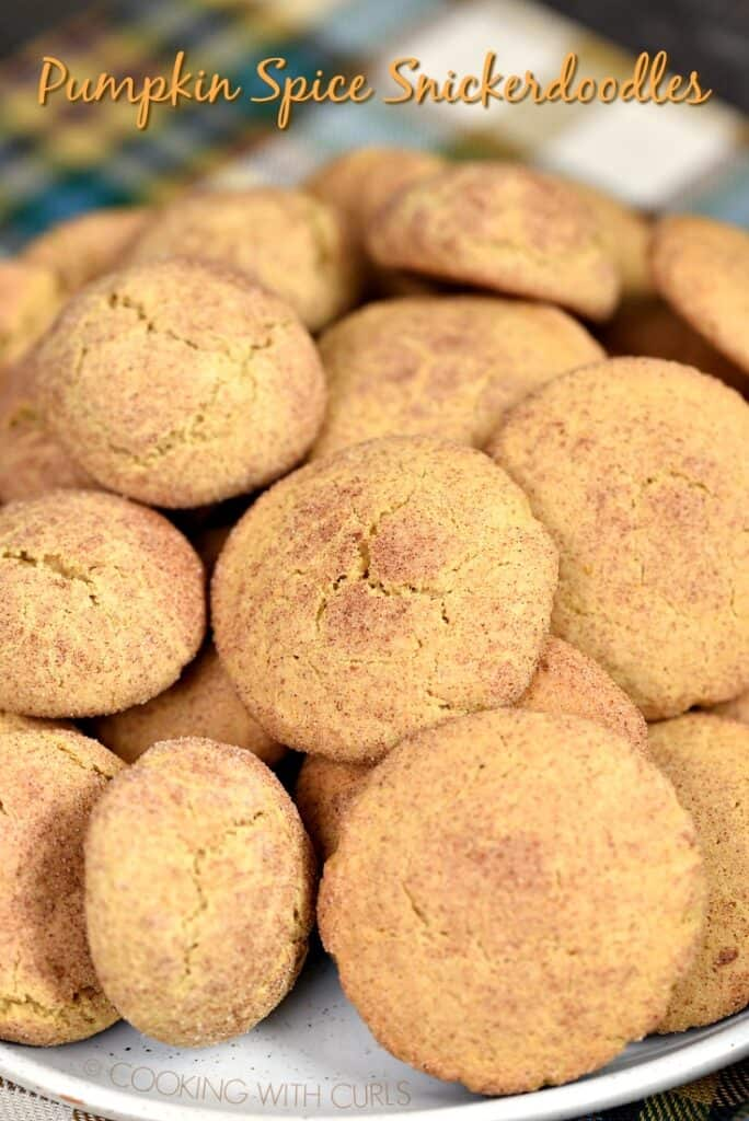 All of your favorite fall flavors are blended together and baked together in these soft and chewy Pumpkin Spice Snickerdoodles! cookingwithcurls.com