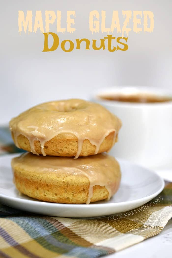 Baked to perfection and topped with a sweet glaze, these Maple Glazed Donuts make a delicious treat any time of day! #breakfast #donuts #baked #recipe #maple #dessert #snack