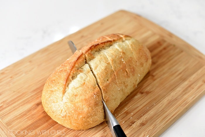 Crusty bread cut on the diagonal with a serrated knife cookingwithcurls.com