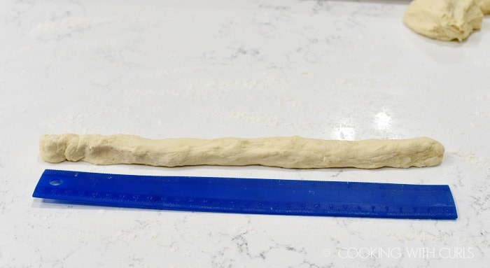 Divide dough into 6 pieces and roll each into a 12-inch rope cookingwithcurls.com