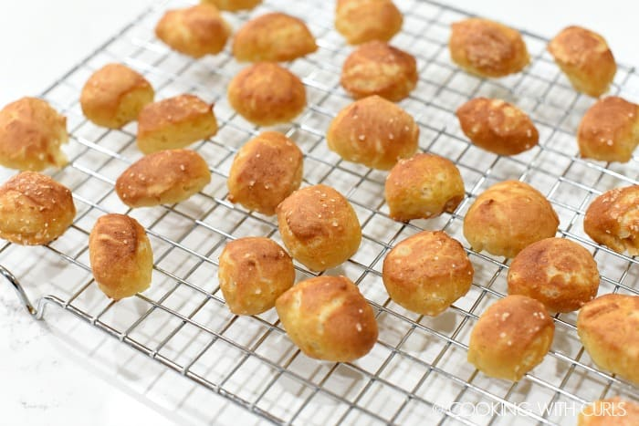 Golden brown pretzel bites on a wire cooling rack cookingwithcurls.com