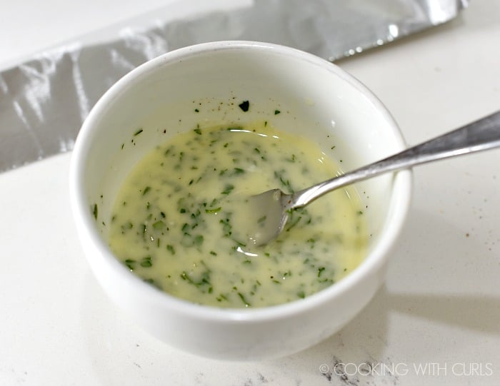 Mix the melted butter, garlic and parsley together in a small bowl cookingwithcurls.com