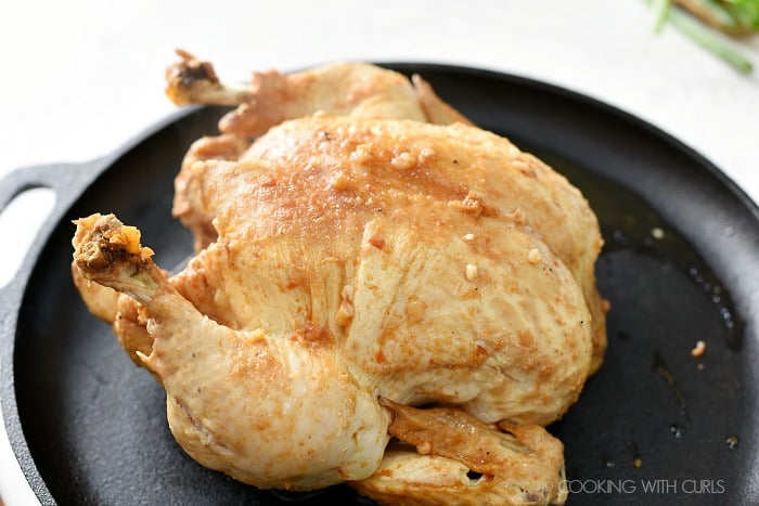 Place the cooked chicken on a cast iron skillet or baking sheet cookingwithcurls.com