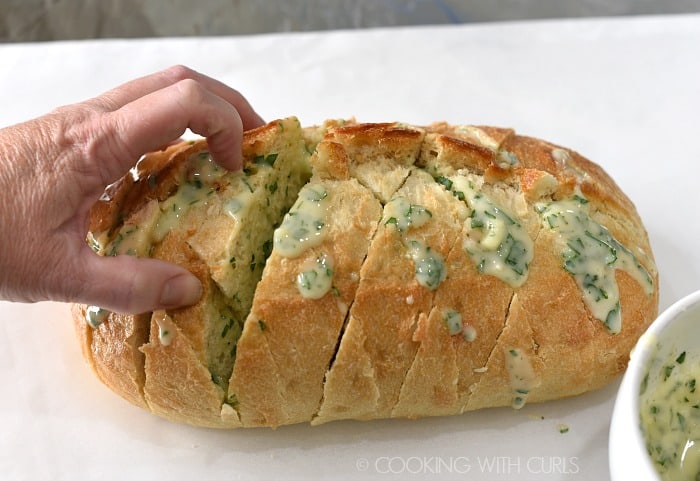 Separate the layers of bread and pour in the garlic butter mixture cookingwithcurls.com