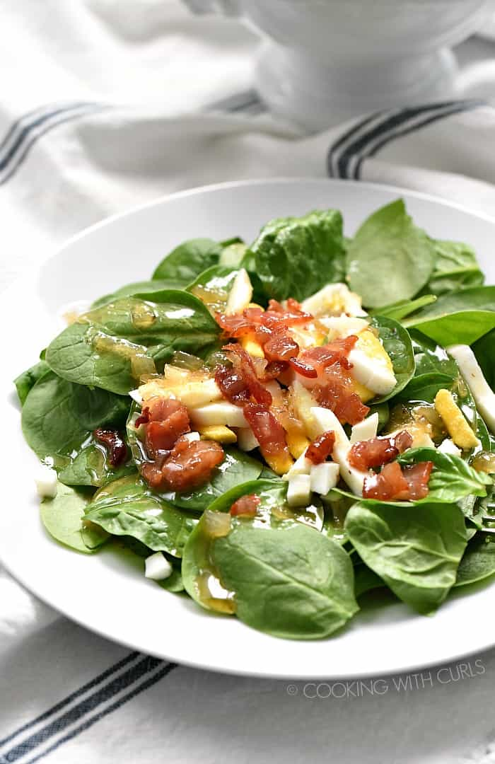 Spinach Salad with Hot Bacon Dressing is not your average salad. It has incredible flavor that will have your family going back for more! cookingwithcurls.com