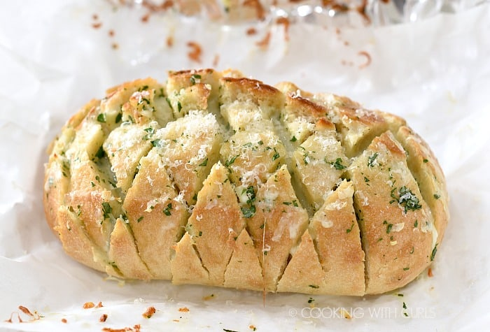 Sprinkle baked Cheesy Garlic Pull-Apart Bread with Parmesan cheese cookingwithcurls.com