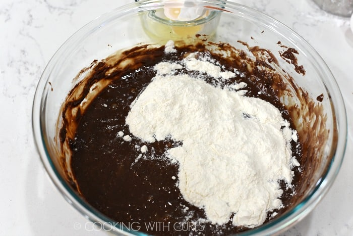 Stir the flour into the chocolate mixture cookingwithcurls.com