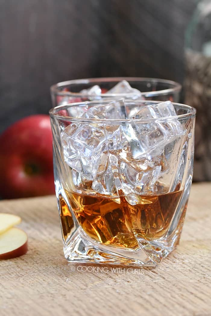 Pour the spiced rum and butterscotch schnapps into a small glass filled with ice cookingwithcurls.com