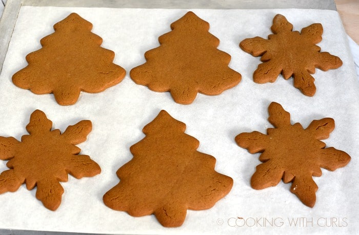 Baked Gingerbread Cookies on a cookie sheet cookingwithcurls.com