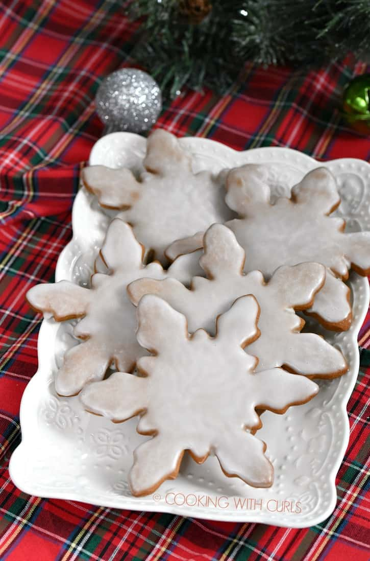 Giant snowflake shaped Gingerbread Cookies dipped in a simple white cookie glaze are an elegant and simple way to decorate large amounts of cookies, especially with kids! cookingwithcurls.com