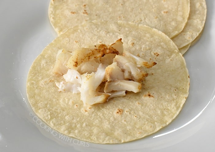 Place fish in the center of a corn tortilla cookingwithcurls.com