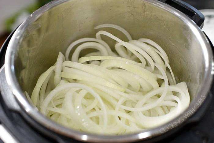 Saute onion slices in a hot pressure cooker cookingwithcurls.com