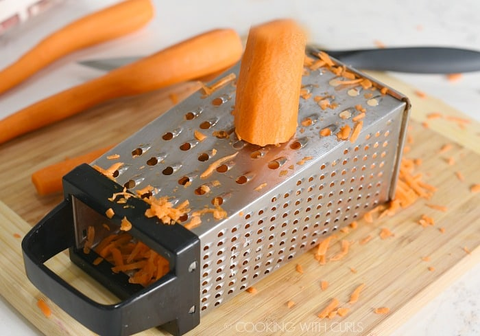 Shred the carrots with a box grater cookingwithcurls.com