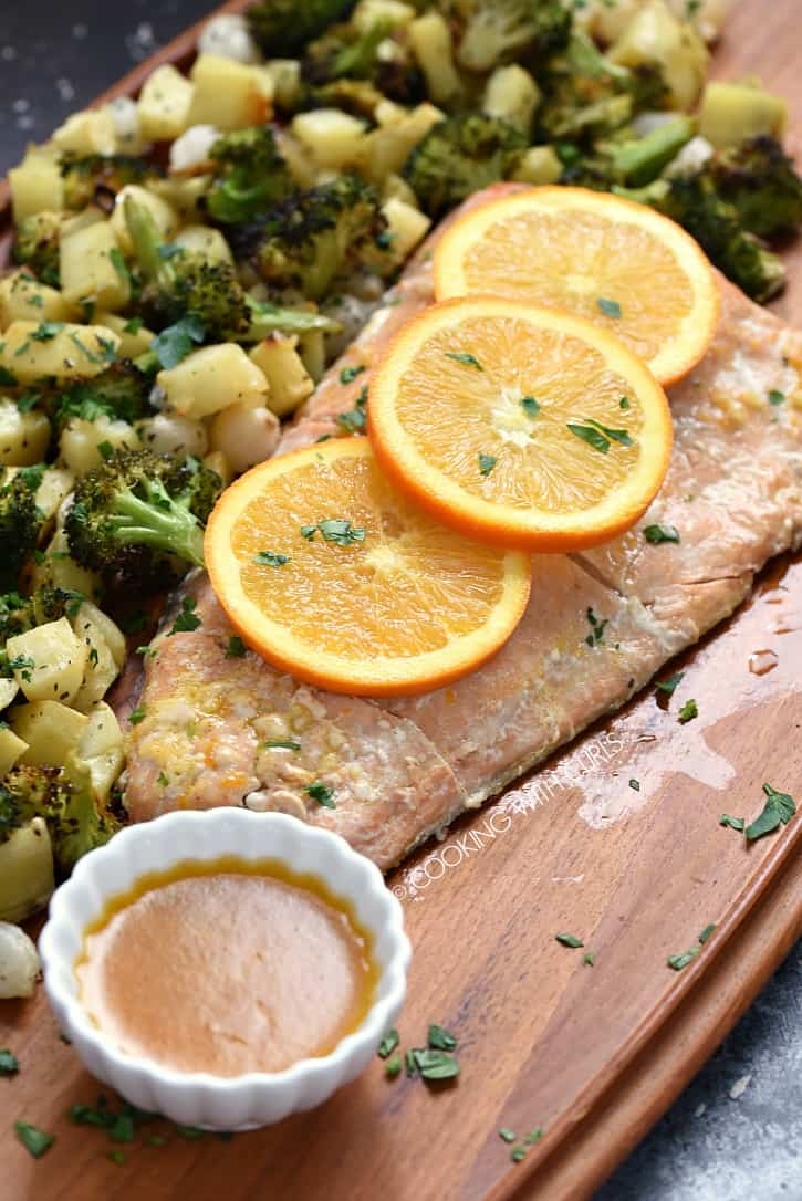 This Orange Salmon with Roasted Vegetable is a quick and easy way to put a delicious meal on the table that the entire family will love! cookingwithcurls.com