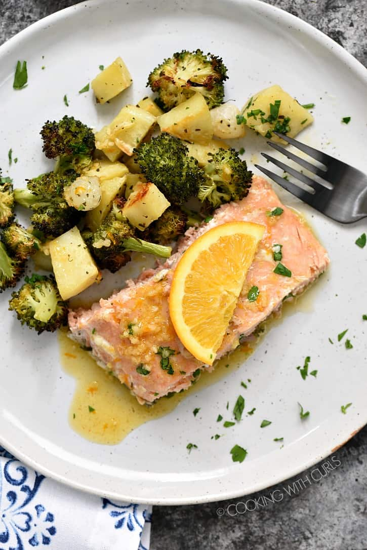 This easy, one-pan Orange Salmon with Roasted Vegetables is full of flavor and healthy too! cookingwithcurls.com