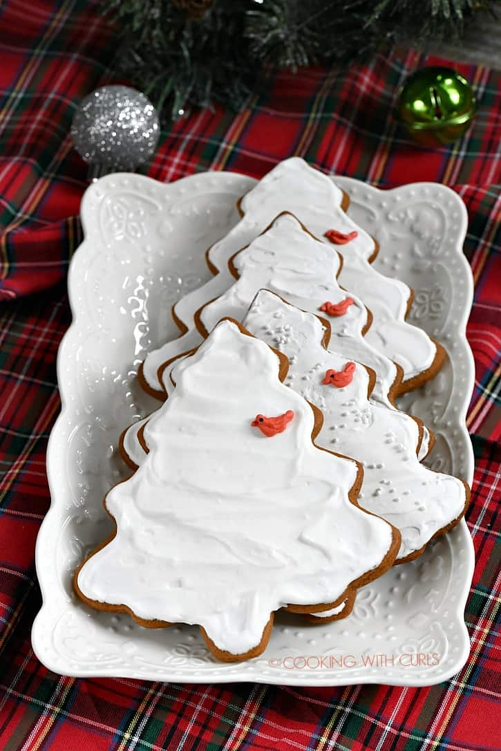 Tree shaped Gingerbread Cookies decorated with white royal icing and cute little cardinals! cookingwithcurls.com