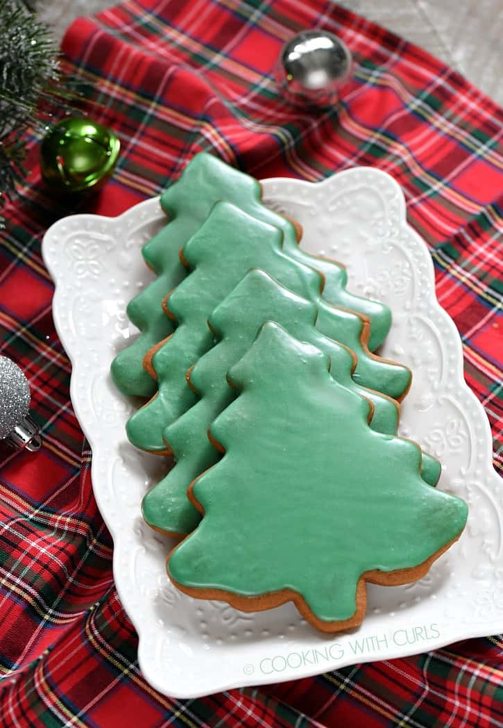 Tree shaped Gingerbread Cookies dipped in a cookie glaze for a simply delicious holiday treat! cookingwithcurls.com