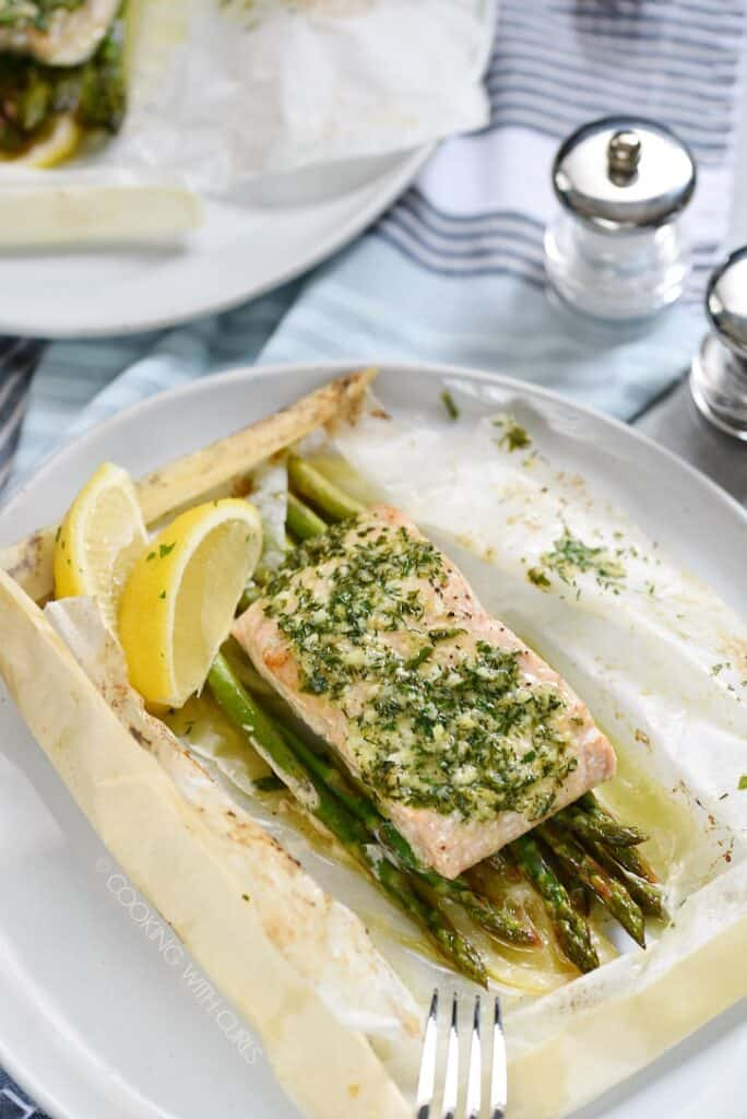 Baked Salmon in Parchment with Asparagus Lemon and Dill is an impressive meal that is simple to prepare! cookingwithcurls.com