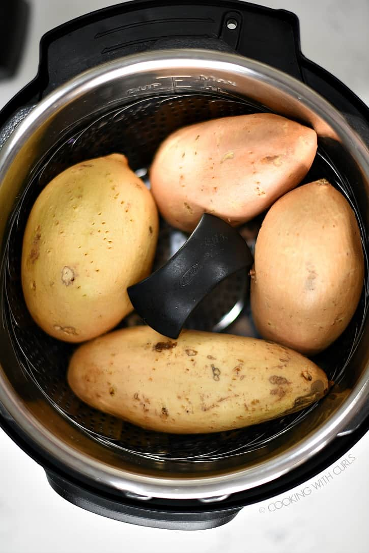 Instant Pot Sweet Potatoes nestled in their pressure cooker! cookingwithcurls.com