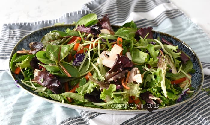 Salad ingredients tossed together in a large serving bowl cookingwithcurls.com