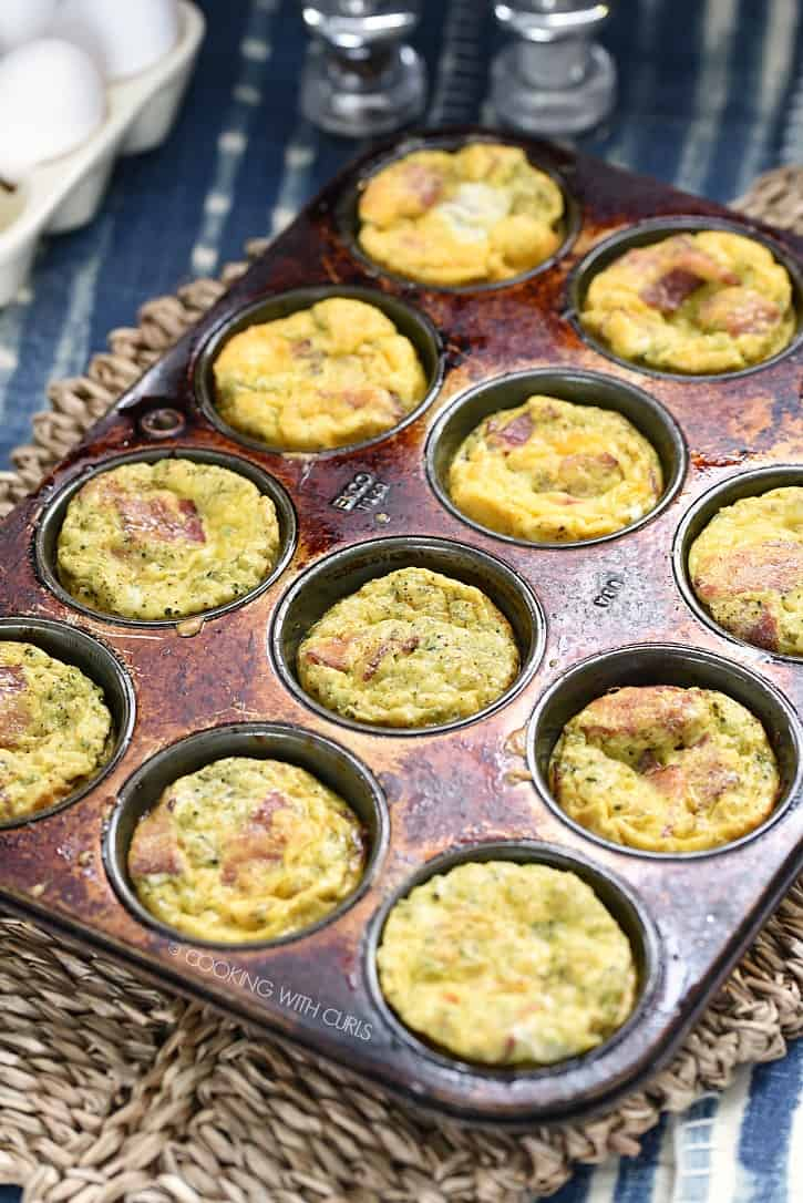 These Breakfast Egg Muffins are an easy and delicious way to eat a low-carb meal while running out the door! cookingwithcurls.com