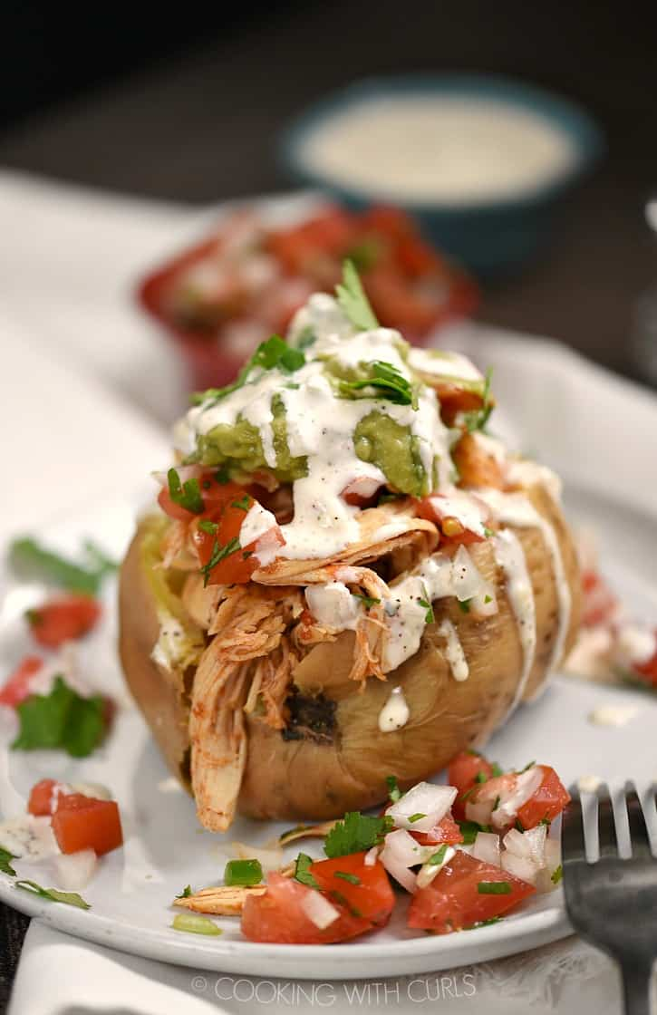 These Chicken Taco Stuffed Sweet Potatoes are insanely delicious, easy to make with an Instant Pot and Whole30 and Paleo compliant!! cookingwithcurls.com